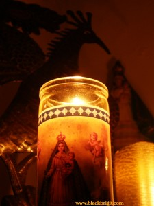 Oshun shrine candle photo by Lilith Dorsey. All rights reserved.