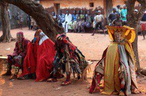 Voodoo Egungun masquerade dancers photo by Deitmar Temps courtesy of Shutterstock.