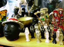 Figurines of Santa Muerte in Mexico City. Image courtesy of wikimedia.