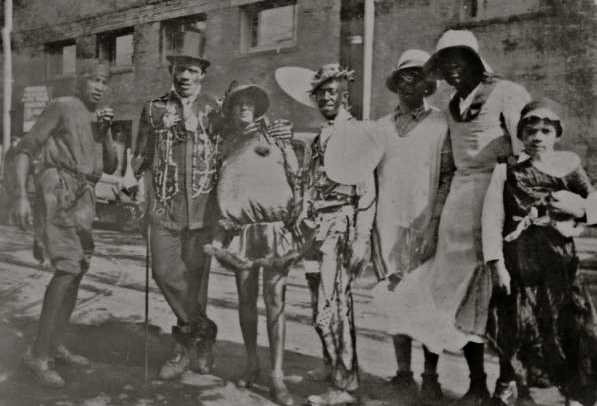 Costumers from Mardi Gras 1930s WPA. Image courtesy of Wikimedia Commons.