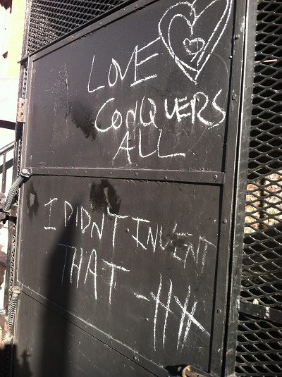 Love conquers all graffiti photo by Lilith Dorsey. All rights reserved.