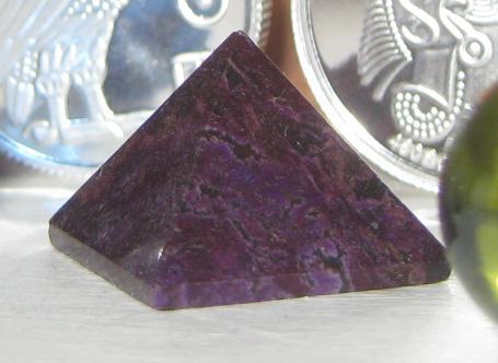 Sugilite pyramid photo by Eric Golub. Licensed under CC 2.0