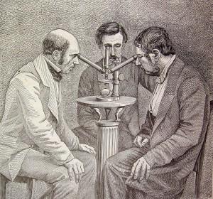 Men looking through microscope