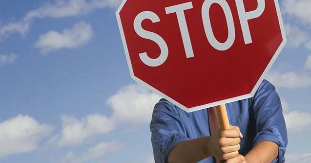 Holding-stop-sign1