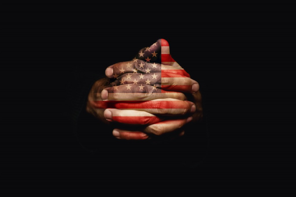 Crossed hands with USA flag