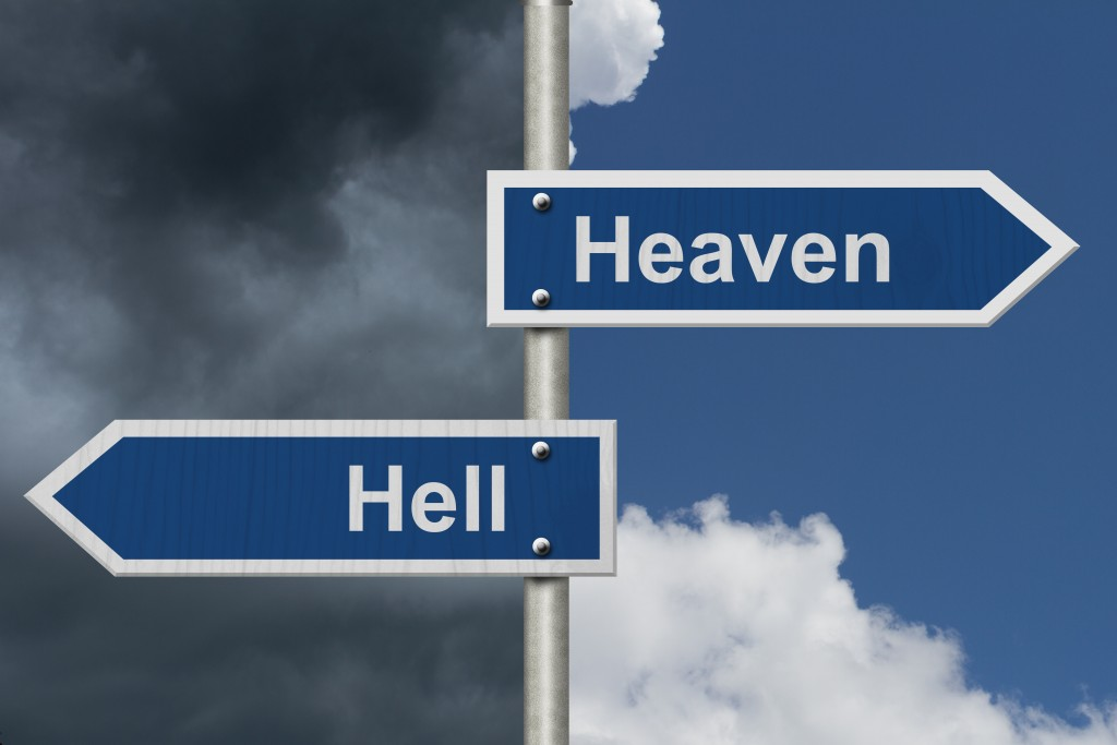 Heaven or Hell, Two Blue Road Sign with text Heaven and Hell with bright and stormy sky background