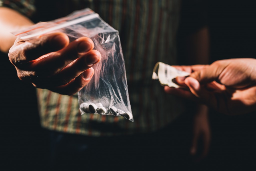 Dealer selling cocaine,ecstasy or other illegal drugs