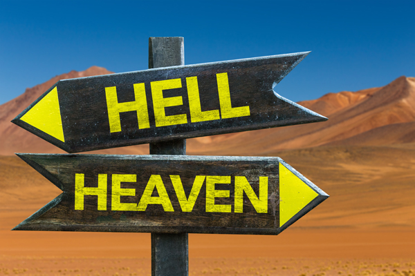 Hell - Heaven signpost in a desert background