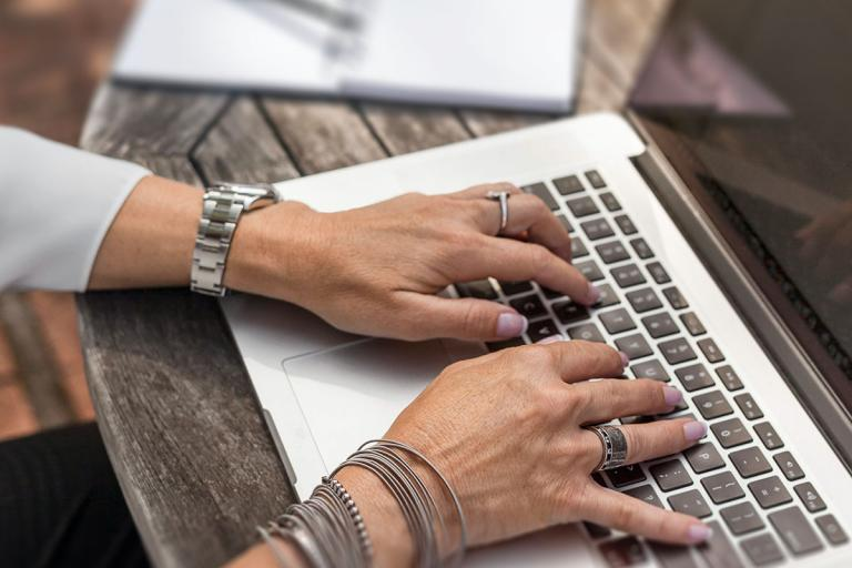 Image of woman typing on a laptop at a desk
