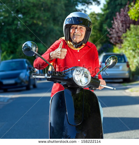 stock-photo-cheerful-senior-woman-on-a-scooter-smiling-old-lady-on-a-scooter-stopped-in-the-street-facing-the-158222114