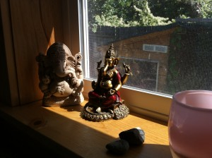 Two of our four Ganeshas, on the left side of the family altar.
