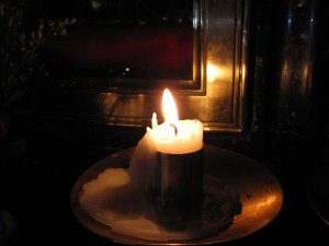 A candle inside the Holy Sepulcher