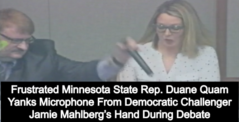 GOP Lawmaker Yanks Microphone Away From His Female Opponent's Hand (Image via Screen Grab)