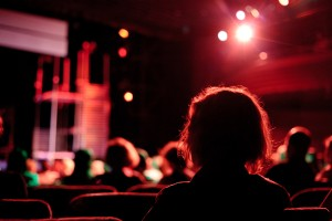 Woman looks at stage