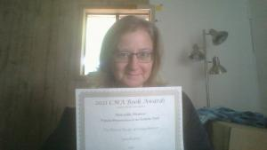 Me with certificate: Honorable Mention, Popular Presentation of the Catholic Faith, 2021 CMA Book Awards