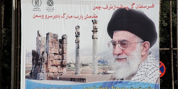 Image: Flickr, Khamenei poster in Persepolis, by Nick Taylor, Creative Commons License, some changes made.