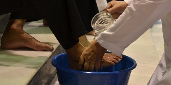 "Photo: Flickr, ""Washing of Foot"" by John Ragal, Creative Commons License, some changes made"