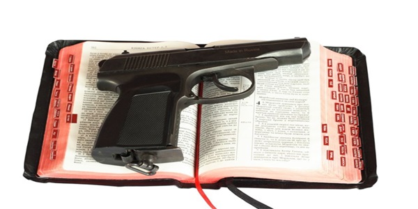 2121129 - the gun on bibles. photo is isolated