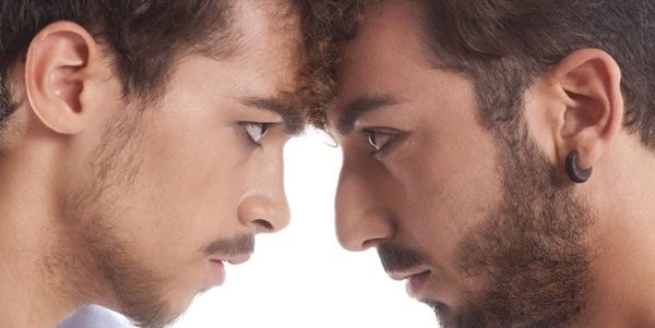 17891772 - two men against each other for conflict and rivalry