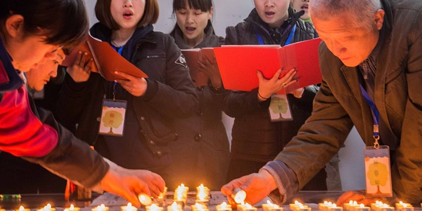 People_lighting_candles_in_a_church 1