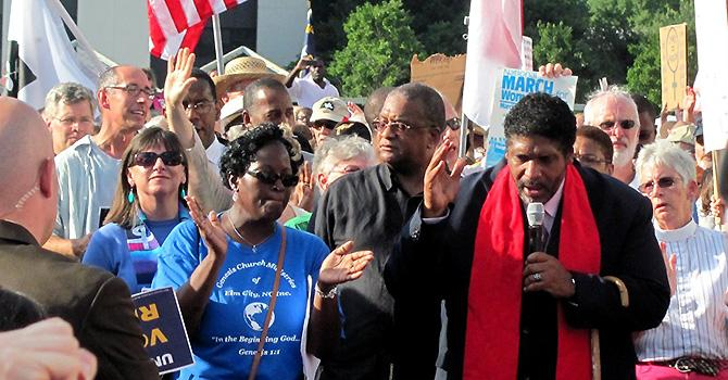 The Rev. Dr. William J. Barber II speaking at a Moral Monday rally. Creative Commons: Flickr / Twbuckner