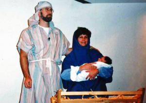 My daughter, Kara, plays the baby Jesus in the church pageant, with Linda and me in supporting roles.