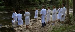 "A brookside baptism, in ""As It is in Heaven"""
