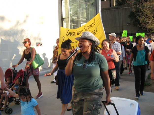 Marching and singing. Mary Hooks of Southerners On New Ground holding the microphone.  I am behind her.