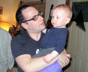 Taken a month after the attack, holding my boy on his first birthday, arm in a purple cast, shirt covered in drool.