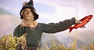 straw man holding a red herring