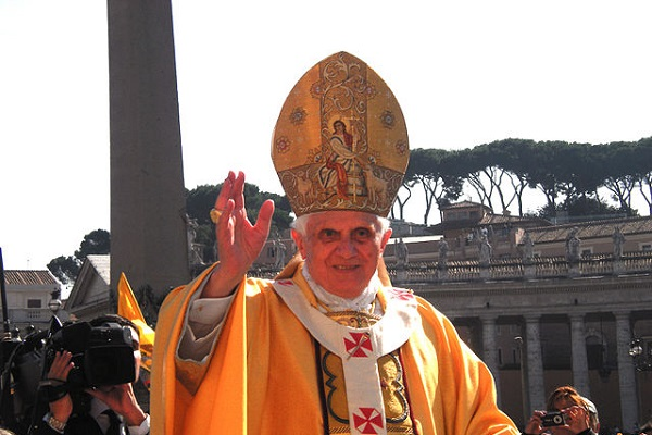 (Pope Benedict XVI performing a blessing during a canonization mass in St. Peter's Square, October 12 [detail], 2008, Author: Rvin88; Wikimedia, CC by 3.0)
