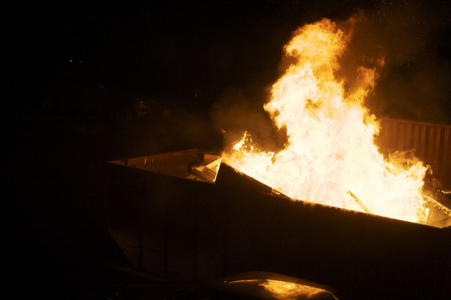 Ben Watts, Fire in Dumpster, 2009; Source: Flickr, CC BY 2.0.