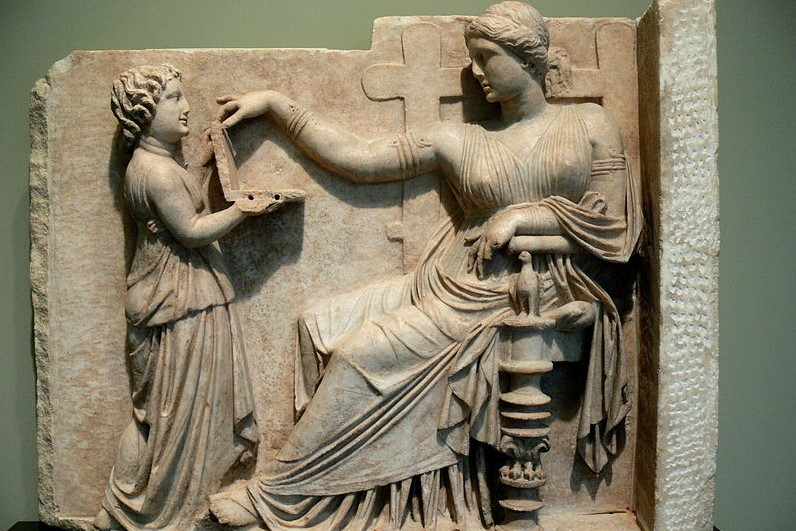 (Gravestone of a woman with her slave child-attendant, Greek, c. 100 BC, Getty Villa, Usa; Source, Wiki Commons, CC BY SA 3.0).