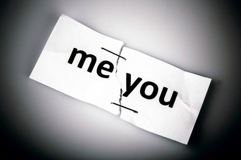"""""""me you"""" words written on torn and stapled paper on white"""