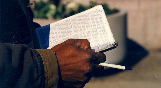 Hand with Bible, by Elvert Barnes. Flickr Commons.