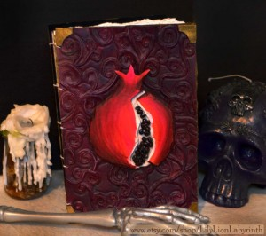 Spectacular handmade leather Persephone pomegranate journal by Lily Lion Labyrinth, available at her Etsy shop, which you can find by clicking the picture. Copyright (c) 2014 by Lily Lion Labyrinth. Used by permission.