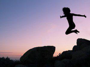 girl-leaping-off-rock-karen-arnold