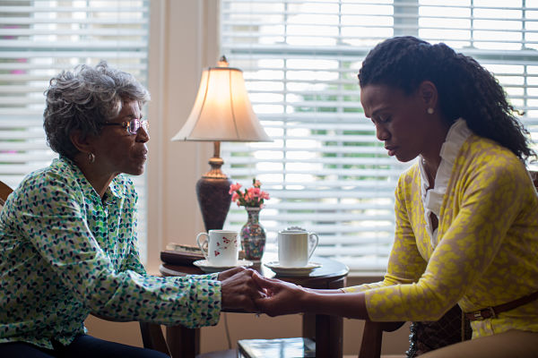 Caption: Miss Clara (Karen Abercrombie) prays with Elizabeth Jordan (Priscilla Shirer) in WAR ROOM.
