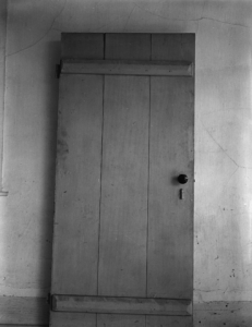 Image: black and white photo of a closet door.