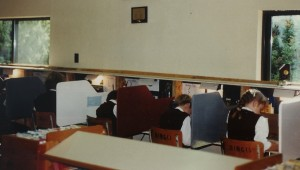 Students in an ACE school, working at the three-sided desks ACE mandates
