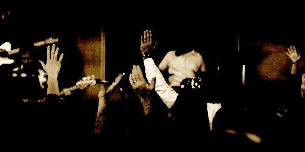 Hands_raised_church_worship_background
