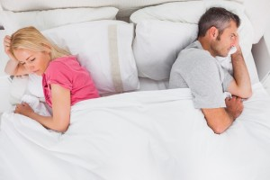 couple in bed not talking