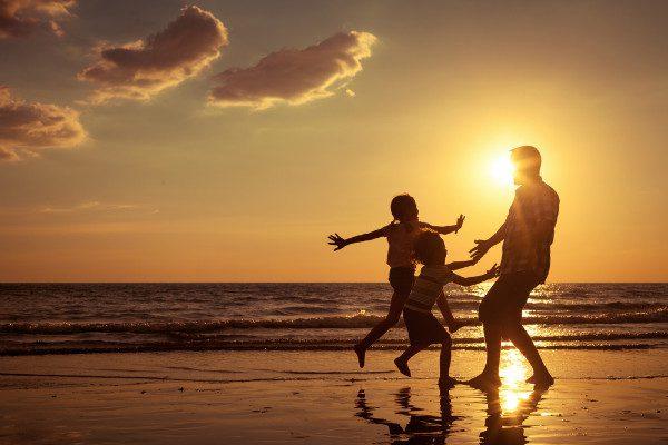 familiy on beach sunset