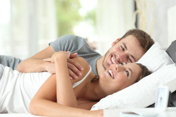 happy couple cuddle