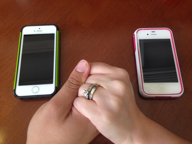 cell phones hold hands