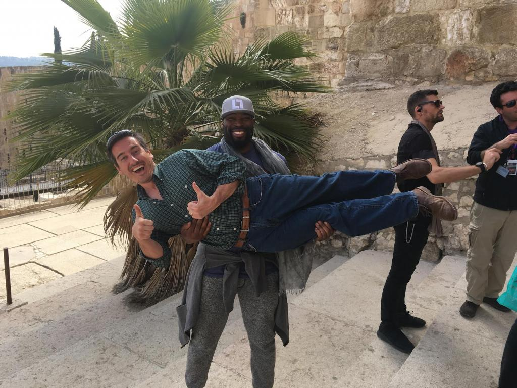 "Being lifted up BY Israel IN Israel. Former NFL player Israel Idonije with Joel Smallbone from the band ""For King and Country"" in the background."