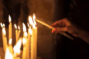 Lighting a candle in prayer