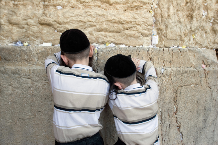 Boys praying at the Western Wall (photo by mikhail/Shutterstock)
