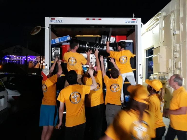 Scientology Volunteer Ministers of Clearwater, Florida, load a 16-foot truck with water, food, emergency kits and other needed supplies and send it off to Boca Raton where it was loaded onto a ship and tansported to Freeport to distribute to victims of Hurricane Dorian.