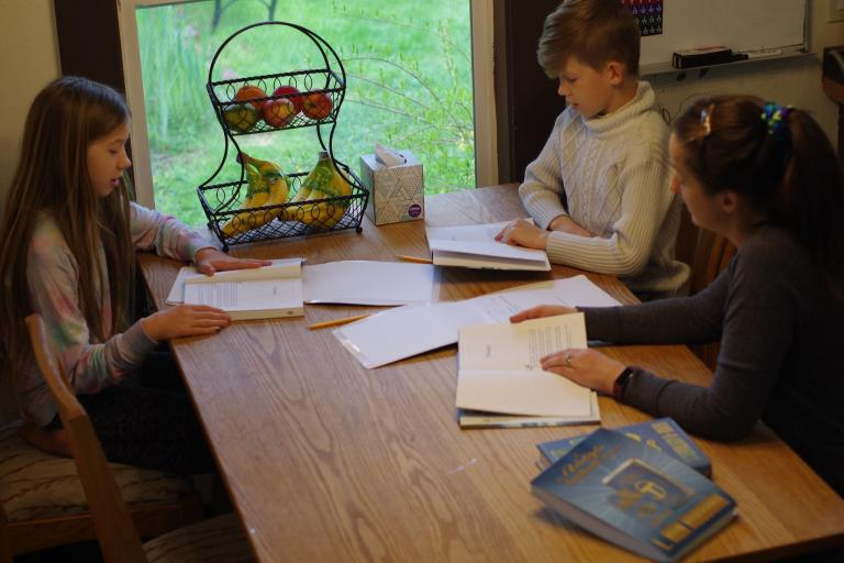 The family working on Scientology extension courses at home.